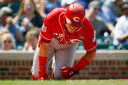 Jul 17, 2019; Chicago, IL, USA; Cincinnati Reds left fielder Derek Dietrich (22) reacts after getting hit by a pitch thrown by Chicago Cubs starting pitcher Yu Darvish (not pictured) during the fifth inning at Wrigley Field.
