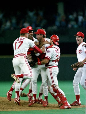 Cincinnati Reds pitcher Tom Browning, center, is congratulated by his teammates Ron Oester, Jeff Reed, Chris Sabo (17) and catcher Jeff Reed (34) after Browning pitched a perfect game against the Los Angeles Dodgers at Riverfront Stadium in Cincinnati, Ohio, Friday night, Sept. 16, 1988.  The Reds won 1-0.