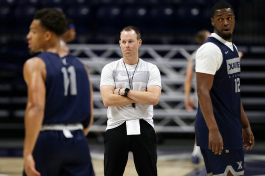 Xavier Musketeers head coach Travis Steele, center, observes the first practice of the season, Wednesday, July 17, 2019, at Cintas Center in Cincinnati.
