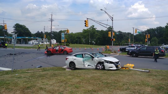 A woman died in a two-vehicle crash at the intersection of Route 130 and Distribution Way in South Brunswick on Wednesday.