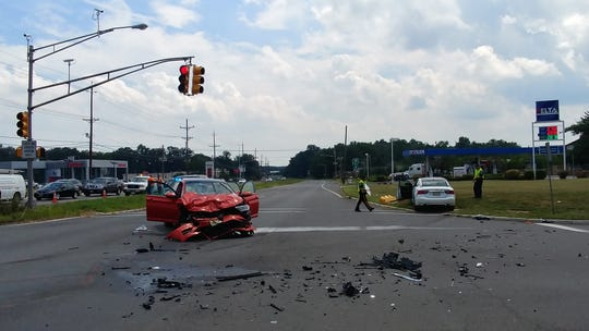 South Brunswick Police are looking for witnesses to this two-vehicle crash at the intersection of Route 130 and Distribution Way in which a woman died Wednesday.