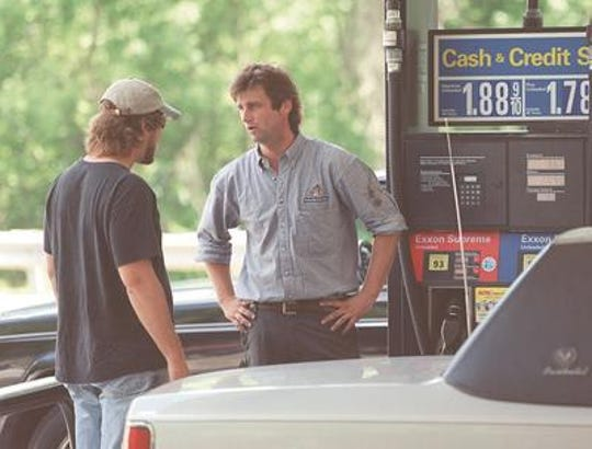 John Schwarz (right) the mechanic at the Exxon in Bernards, where a worker was killed on June 29, 2000 speaks to a visitor. Schwarz, was friends with and knew the victim for the ten years they worked together at the gas station.