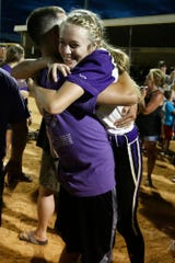 Indianola sophomore Kate Kralik gets a hug. Indianola came from behind to tie the game in the bottom of the seventh then won 5-4 in the ninth to beat Southeast Polk in a Class 5A regional final.