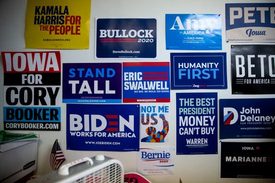Presidential campaign signs hang on the wall inside the Clinton County Democrats' office on Tuesday, July 17, 2019, in Clinton, Iowa.