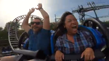 Des Moines Register staffers Zach Boyden-Holmes and Linh Ta go for a ride on Adventureland's new coaster the Phoenix