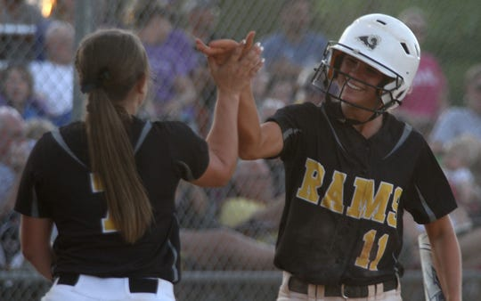 Southeast Polk junior Bri Vasey and junior Gretta Hartz share a high five. Indianola came from behind to tie the game in the bottom of the seventh then won 5-4 in the ninth to beat Southeast Polk in a Class 5A regional final.