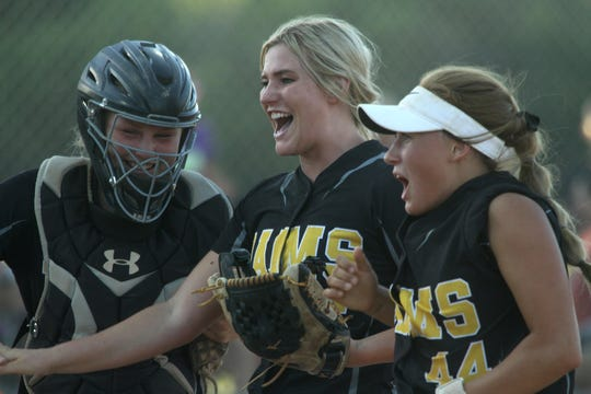 Southeast Polk softball pitcher Lexi Hilzer, center, is swarmed during the Class 5A regional final game in July, 2019 after striking out an Indianola player. However, Indianola came from behind to tie the game in the bottom of the seventh then won 5-4 in the ninth to beat Southeast Polk. With Hilzer are senior catcher Peyton Moffet, left, and sophomore Abbi Cataldo, right.