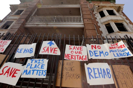 Disputes over gentrification in Detroit: Signs hang on the fence around the Atlanta building on Cass Avenue where people gathered to raise awareness about the value of preserving historic buildings and asked that a group of buildings including the Atlanta and Hotel Ansonia not be demolished in Detroit on Thursday, August 24, 2017.