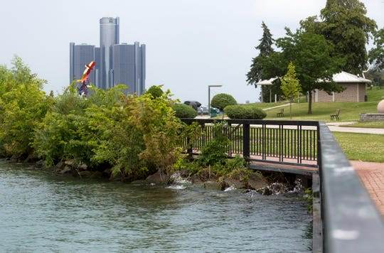 Water levels rise just a few feet below the pier along the Detroit River seen from the Windsor Sculpture Park, Windsor, Ontario, Tuesday, July 16, 2019.