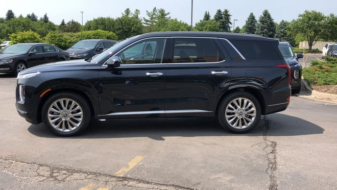 The 2020 Hyundai Palisade seats seven or eight and has some unique features.