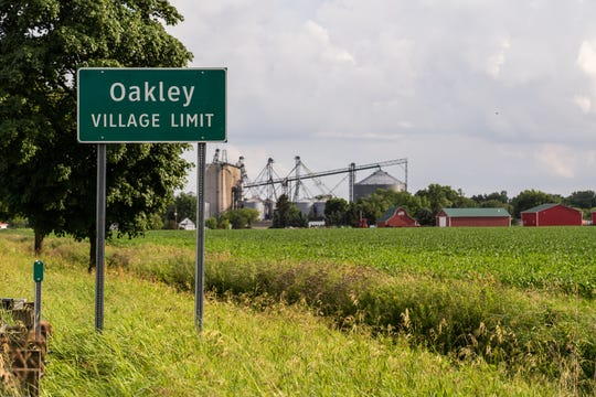 Sign for the village of Oakley is seen on Oakley Rd. on Tuesday, July 2, 2019.