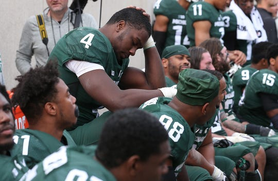Malik McDowell of the Michigan State Spartans sits on the bench late in the fourth quarter during the game against the Michigan Wolverines at Spartan Stadium on October 29, 2016 in East Lansing. Michigan defeated Michigan State 32-23.