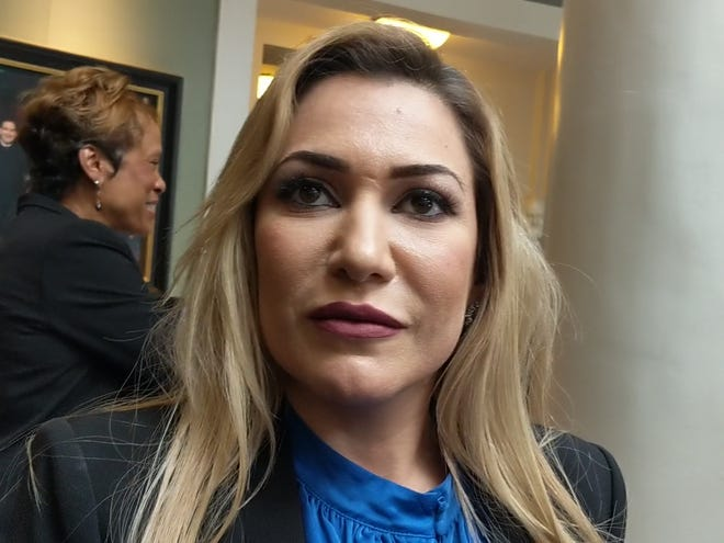 Solicitor General Fadwa Hammoud talks to reporters outside the Michigan Supreme Court on July 17, 2019.