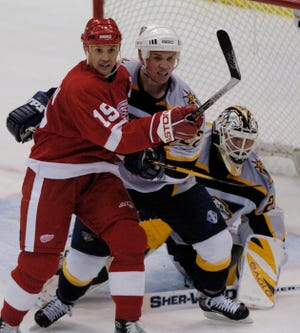 Greg Johnson, here battling with Steve Yzerman in front of the net, was traded to Pittsburgh by Detroit in 1997.