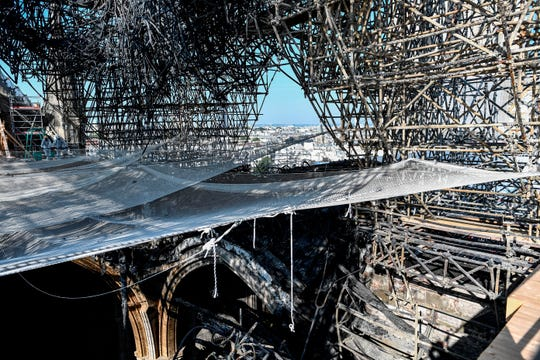 Parts of a destroyed ribbed vault and scaffolding are pictured at the Notre-Dame de Paris Cathedral, Wednesday, July 17, 2019 in Paris. The chief architect of France's historic monuments says that three months after the April 15 fire that devastated Notre Dame Cathedral the site is still being secured.