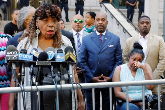 Gwen Carr, mother of chokehold victim Eric Garner, left, speaks outside the U.S. Attorney's office, in the Brooklyn borough of New York, as Garner's widow Esaw Snipes listens at right, Tuesday, July 16, 2019.
