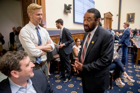Rep. Al Green, D-Texas, right, speaks to visitors during a break from testimony from David Marcus, CEO of Facebook's Calibra digital wallet service, before a House Financial Services Committee hearing on Facebook's proposed cryptocurrency on Capitol Hill in Washington, Wednesday, July 17, 2019. Green has introduced a resolution in the House to impeach President Donald Trump.