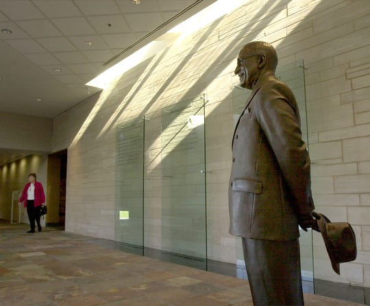 FILE -- A visitor enters a contemplation area containing a life-sized statue of Harry S. Truman, Dec. 19, 2001, at the Truman Presidential Museum and Library in Independence, Mo. The display is part of a 11,000-square foot exhibit recently opened as part of a $22.5 million renovation.