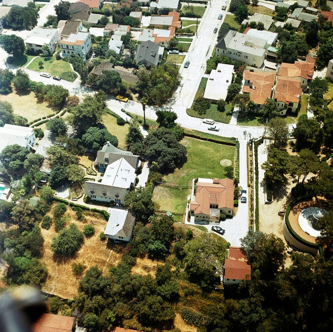 In this Aug. 13, 1969, file photo an aerial view of the home of Leno and Rosemary LaBianca in the Los Feliz district of Los Angeles. The home, which is one of the Los Angeles houses where followers of Charles Manson committed notorious murders in 1969, is for sale.