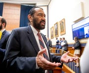 Rep. Al Green, D-Texas, right, speaks to visitors during a House Financial Services Committee hearing on Facebook's proposed cryptocurrency, Wednesday, July 17, 2019. The House easily killed Green's effort Wednesday to impeach President Donald Trump for his recent racial insults against lawmakers of color.