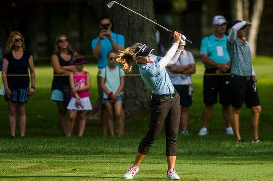 Brooke Henderson hits a shot during the first round of the Dow Great Lakes Bay Invitational on Wednesday at Midland Country Club.