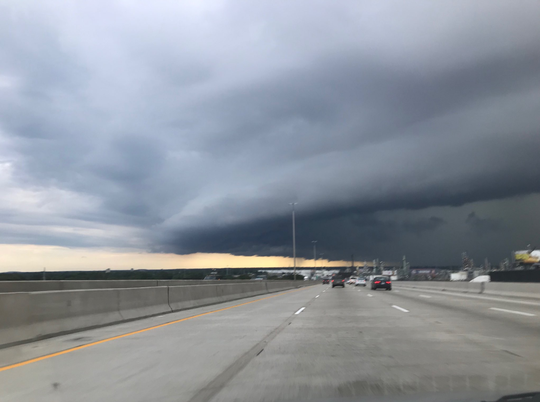 A storm cloud seen from the Rouge River bridge on southbound Interstate 75 in metro Detroit.
