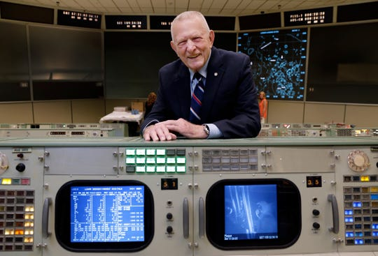 Gene Kranz, the most prominent of the Apollo era flight directors and later Director of NASA Flight Operations, stands behind the console where he worked during the Gemini and Apollo missions,  Monday, June 17, 2019, in Houston.