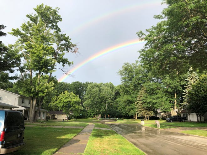 A double rainbow emerges after the storm near 12 Mile Road in Southfield.