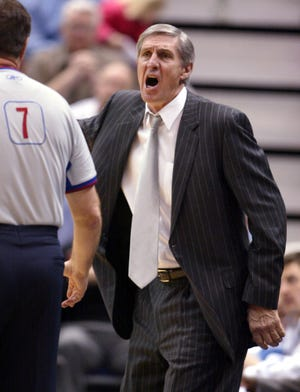 Utah Jazz coach Jerry Sloan gives an official a piece of his mind during a game against the Seattle Sonics in 2005 at Salt Lake City.