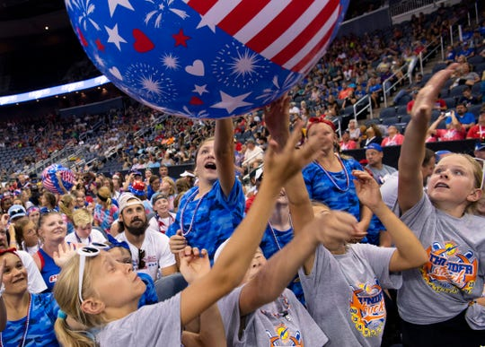 The floor of the Ford Center was packed with softball players from around the country for the USSSA Indiana Great Lakes Nationals softball tournament in Evansville Tuesday evening, July 7, 2019. The party atmosphere offered beach balls, climbing walls and inflatables for the players, but the coronavirus pandemic's shelter-in-place order has put the hotel industry in dire economic straights.