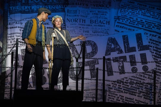 """Jack Kelly, played by Eli Fanok, and Crutchie, played by Alyssa Chaffee in a scene during a dress rehearsal of the Warrick County School Corporation and the Warrick Public Education Foundation's 23rd summer musical """"NEWSIES."""" The play that usually only casts males will use both male and female cast members Tuesday, July 16, 2019."""