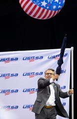 Evansville Mayor Lloyd Winnecke takes a swing at a beach ball to kick off the USSSA Indiana Great Lakes Nationals softball tournament in Evansville earlier this year. The party atmosphere offered beach balls, climbing walls and inflatables for the players before they began tournament play at area softball venues Wednesday morning.