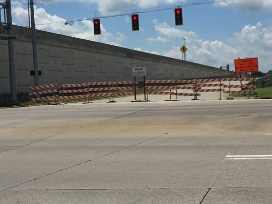 These barriers stopping motorists from traveling westbound on Lloyd Expressway from Division Street and Fulton Avenue could be gone by Monday, weather permitting.