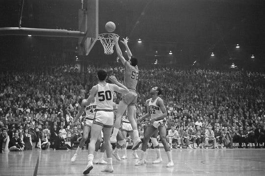 Jerry Sloan puts up a shot  during the 1965 NCAA College Division Championship game at Roberts Stadium. UE won over Southern Illinois 85-82.