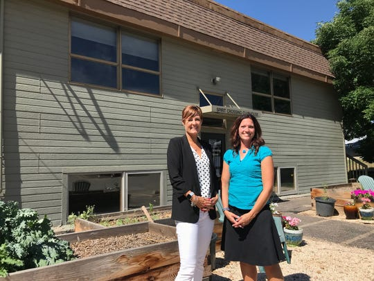 Shirley Peel, left, and Trish Wadsworth stand in front of Christian Core Academy's new home in Fort Collins July 16, 2019. After more than a decade of moving from church to church, the school secured a permanent location. It will begin serving students in the 2019-20 school year.