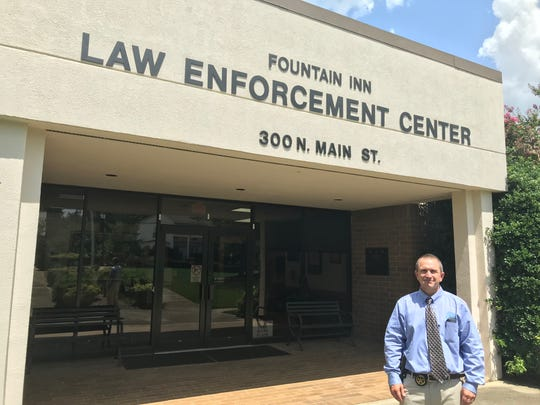 New Fountain Inn Police Chief Michael Hamilton poses for a photo outside the city's police department on Tuesday, July 16, 2019.