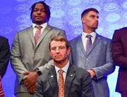 These are not the faces of underdogs. Clemson lineman John Simpson, left, coach Dabo Swinney and safety Tanner Muse pose during the preseason ACC Media Football Kickoff. Clemson was once again selected to win the conference championship.