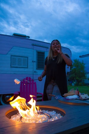 """Enya Spicer eating a smore at the """"Dottie"""" camper in White Sulphur Springs"""