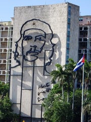 The likeness of Che Guevarra on the side of a building in Revolution Square.