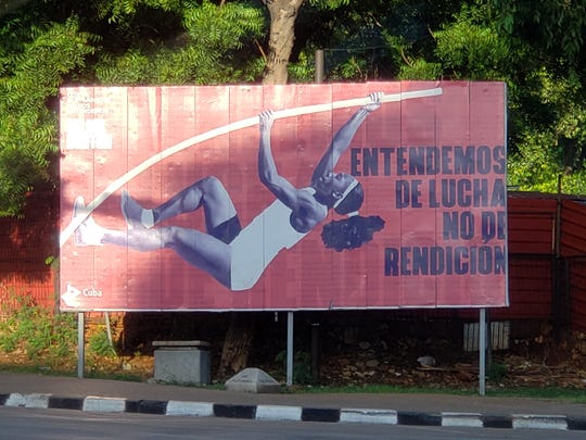 A poster of a girl pole vaulting proclaiming they will fight the embargo.