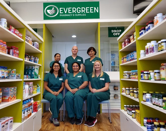 Evergreen Pharmacy & Supplies opens July 22nd at the Staywell Building in Maite. Pictured in the front row are pharmacy technicians (left to right) Saleena Pablo, Chielo Ebeo and Jessica Reinhardt. Pictured in the back row is (left to right) Elaine Aguon, cashier; Gary Roy, manager; and Vangie Phillips pharmacist.