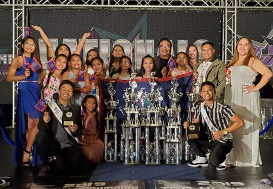 Stargazers Dance Troupe competed in the Luv2dance National Dance Competition held July 1-5 at Orlando, Florida. Pictured with the group is Mark Gonzales who won best choreography.