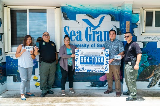 University of Guam Sea Grant provided the Guam Department of Agriculture with the 864-TOKA hotline phone for island residents to report threats to fish and wildlife 24/7. (From left) Fran Castro, program leader, UOG Sea Grant; Lt. Mark Aguon, officer in charge, Guam Department of Agriculture Law Enforcement Section; Chelsa Muna-Brecht, director, Guam Department of Agriculture; Austin Shelton, director, UOG Sea Grant; and Nathan Rios, conservation officer, Guam Department of Agriculture Law Enforcement Section.