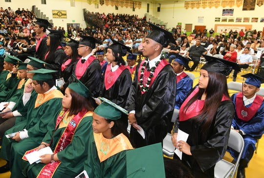 Graduating seniors from J.P. Torres Success Academy are acknowledged during the Class of 2019 Rainbow Graduation Ceremony at John F. Kennedy High School in Tamuning in this July 17, 2019, file photo.