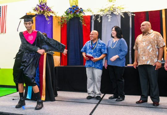 J.P. Torres Success Academy graduate Brendon Uncangco shakes and shimmies in celebration on stage just before receiving his diploma during the Class of 2019 Rainbow Graduation Ceremony at John F. Kennedy High School in Tamuning on Wednesday, July 17, 2019. One-hundred thirty-one seniors, from John. F. Kennedy High School, George Washington High School, Okkodo High School, Simon A. Sanchez High School, Southern High School, Tiyan High School and J.P. Torres Success Academy, who have earned their required credits during the summer break, graduated and received their high school diplomas during the event.