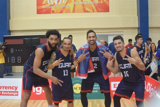 In this file photo from July 2019, the two-time gold medalists of Guam's Men's Basketball Team share the sweetness of success. They are, from left: Jonathan Galloway, JP Cruz, Tai Wesley and Willie Stinnett. The four are part of the Bank of Guam Men's Basketball Team that will play against New Zealand on Sunday in a FIBA Asia Cup Qualifier.