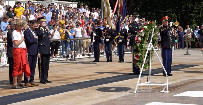 Del. Mike San Nicolas and others from Guam take part in the 75th Anniversary Liberation of Guam's wreath presentation at the Tomb of the Unknown Soldier in Arlington National Cemetery in Virginia.