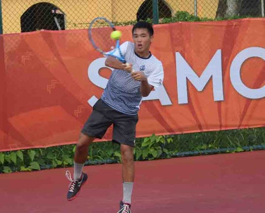 Camden Camacho hits a backhand in this July 17 fiole photo at the Pacific Games in Samoa. Camacho lost his quarterfinal singles match 6-1, 6-0.