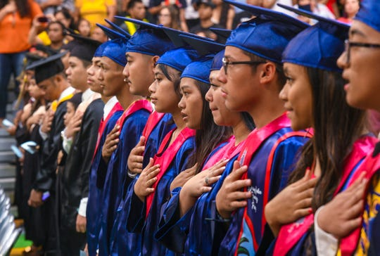 The national anthem is performed during the Class of 2019 Rainbow Graduation Ceremony at John F. Kennedy High School in Tamuning in this July 17 file photo.