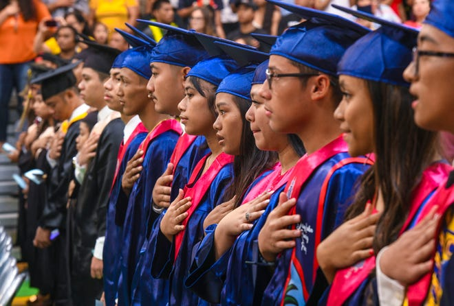 The national anthem is performed during the Class of 2019 Rainbow Graduation Ceremony at John F. Kennedy High School in Tamuning on Wednesday, July 17, 2019.